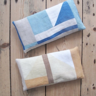 Two patchwork pillows